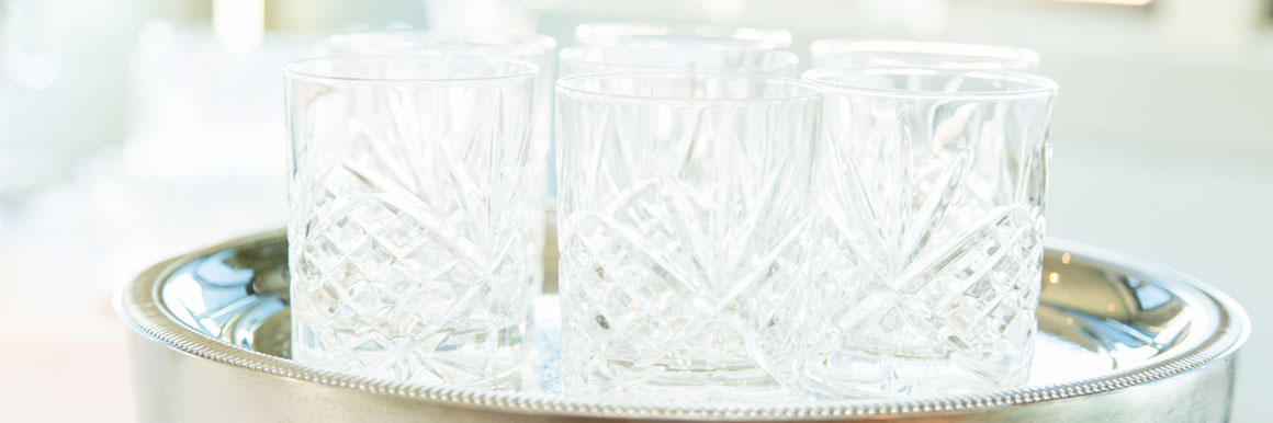 glassware on sliver serving tray