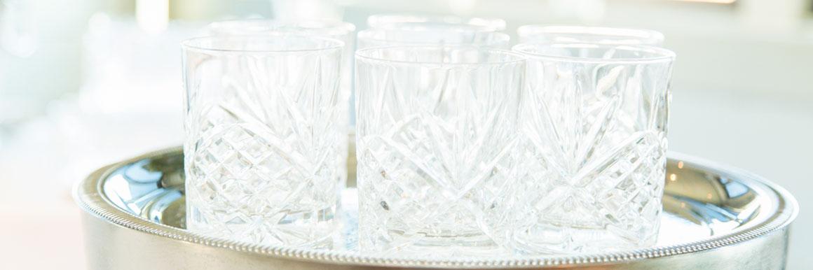 glassware on sliver serving tray