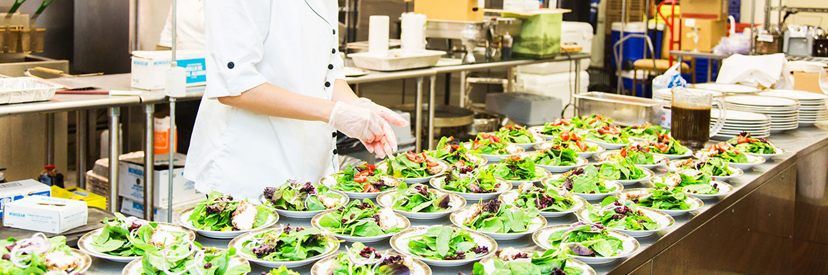 caterer preparing salad