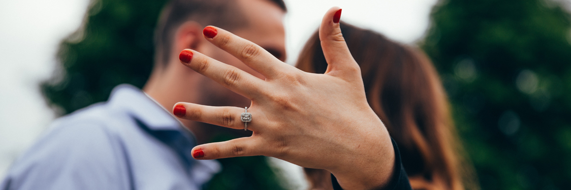 Woman with engagement ring with fiance